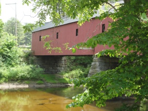 Pretty view of covered bridge through the trees