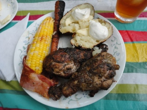 Chicken, Corn on the cob, carrots, and baked potatoes 100% cooked over the fire