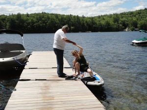 Dad helping Katy up...the dock is pretty wobbly