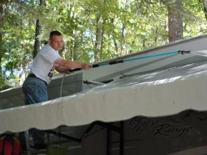 Spraying the awning
