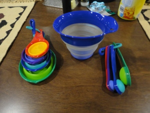 Collapsible spoons, cups, and a liquid cup measurer