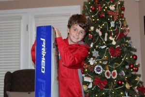 Alec with one of the soccer goals. It was a soccer themed Christmas