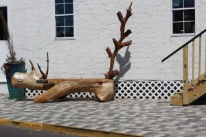 Very cool dinosaur log bench