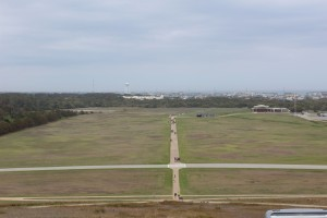 The monument is on a Hill overlooking the first runway