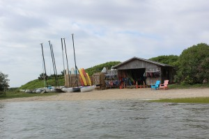 A vendor rents sailboats, kayaks etc right in the park