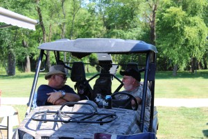 Craig and Red in Red's ATV. The dogs like to hang out in back