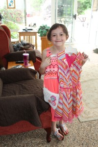 My niece Elise with the dress and purse I bought her for her birthday