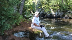 Linda sitting on a rock enjoying the view