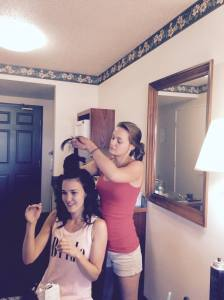 Kyrston fixing Katy's hair