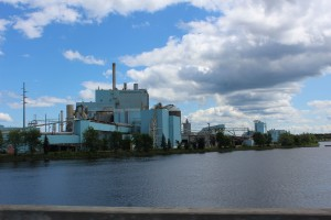 Industrial buildings all along the river around the border crossing