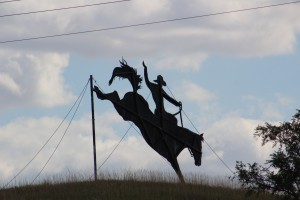 A Hillside metal sculpture of a cowboy on a horse