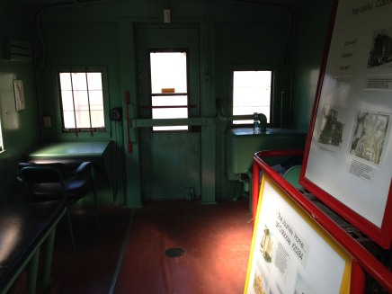 The conductor and two brakemen lived in the caboose and this was their stove/heat and office area