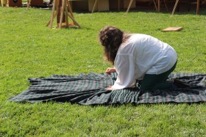 Make the pleats on the ground by folding over cloth