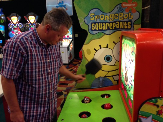 Lee playing Whack a Mole