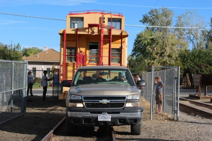 Stan pulling the caboose with the truck