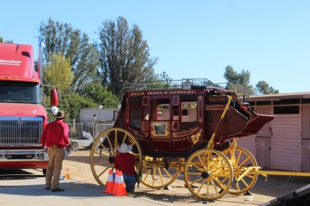 The Wells Fargo wagon is a coming down the street