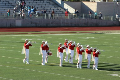 The heralds play 15 new compostions every year during the 5 mile parade march