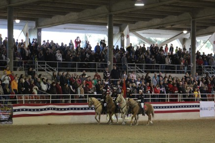 The national anthem was song and accompanied by this horseback color guard