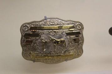 Many dignitaries gave him custom belt buckles