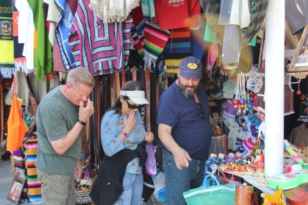 Roger, Brenda, and Mario checking out some street vendor wares