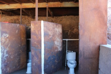 The wall behind the stalls was packed dirt which was cooler than the picture suggests. The dorrs are heavy iron.