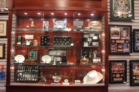 A huge case full of sports memorabilia