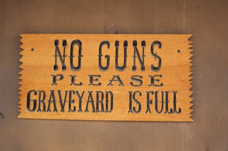 Sign on the door. We say no firearms signs on many of the stores, but this one was funny