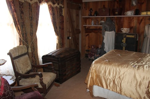 The old trunk in this bedroom was beautiful and has been in his family for over 100 years