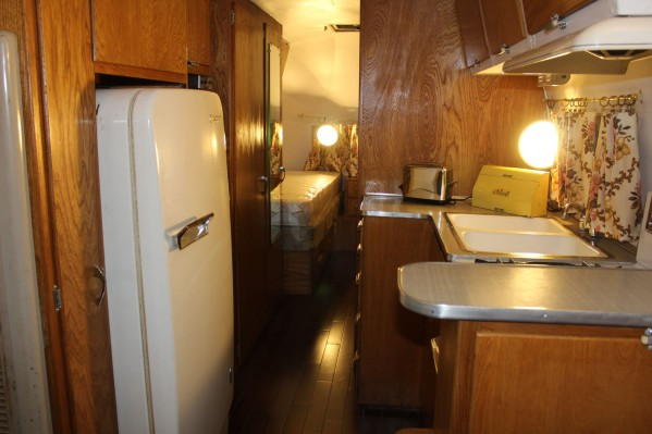 The inside of the aristream with a really nice fridge