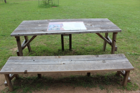 He signed some major education into law right here on this bench outside the school house