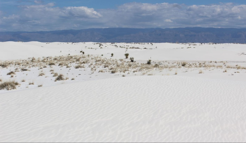 The vast expanses of sand with mountains in the background was great
