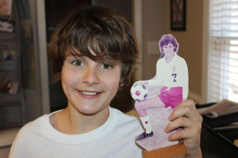 Alec holding a picture of his Aunt Tracy from high school. We even had the same hair!!