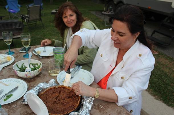 Sharon wathcing Bridget cutting her sweet potato and pecan pie