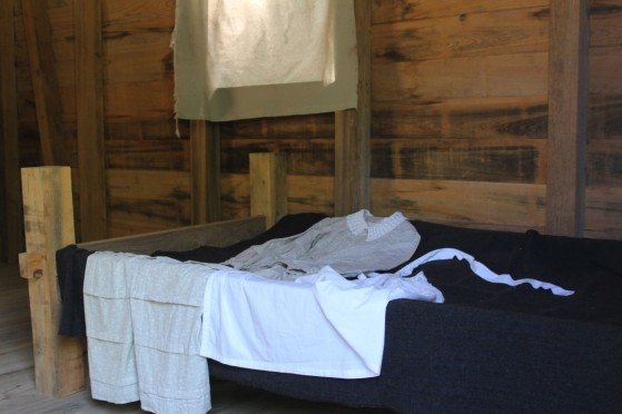 The bed and uniform of one of the house slaves