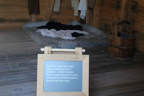 Versus the bed and clothes of one of the field slaves who raised numerous children in this one room