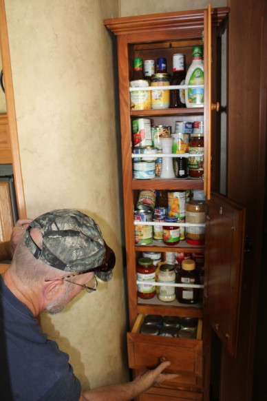 Chris bought an unfinished pantry, bolted it in and then stained it to match. Since I am pantryless I was very interested