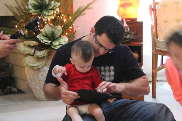 Lex with Eddie showing us how he can play Ipad games. IT's really amazing for an 18 month old