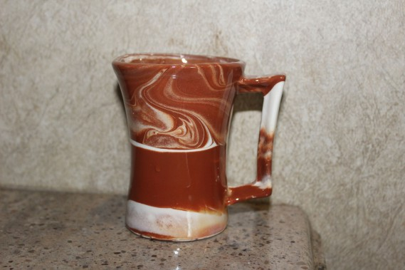I bought this cool $8 coffee cup made locally from Alaska clay. Love, love it!