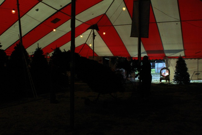 Moving to the front center of the tent