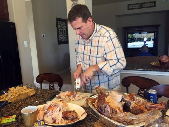 Greg is very serious about cutting the turkey
