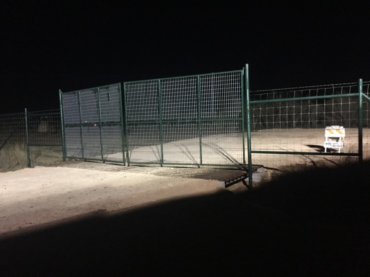 Newly painted gate lit up at night